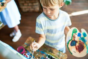 Little Boy Painting Picture